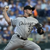 Sep 6, 2015; Kansas City, MO, USA; Chicago White Sox pitcher David Robertson (30) delivers a pitch against the Kansas City Royals during the ninth inning at Kauffman Stadium. Mandatory Credit: Peter G. Aiken-USA TODAY Sports